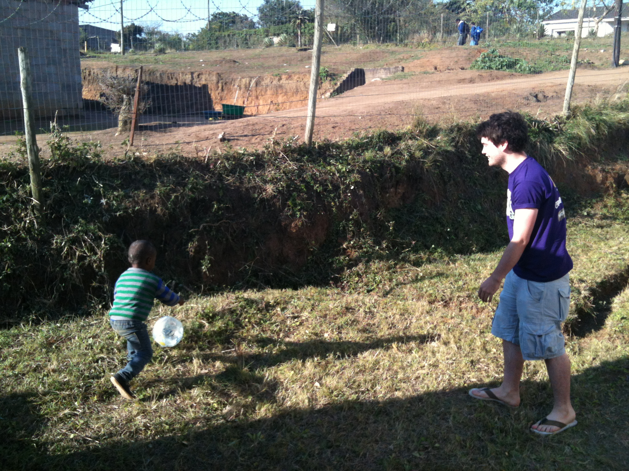 James playing football with a local
